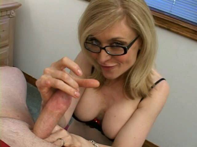 Sensational blonde granny in glasses Nina Hartley slurping a monster dong