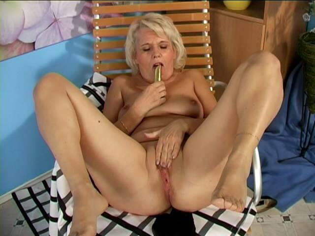 Lustful blonde grandmother Leona fucking a dildo hard