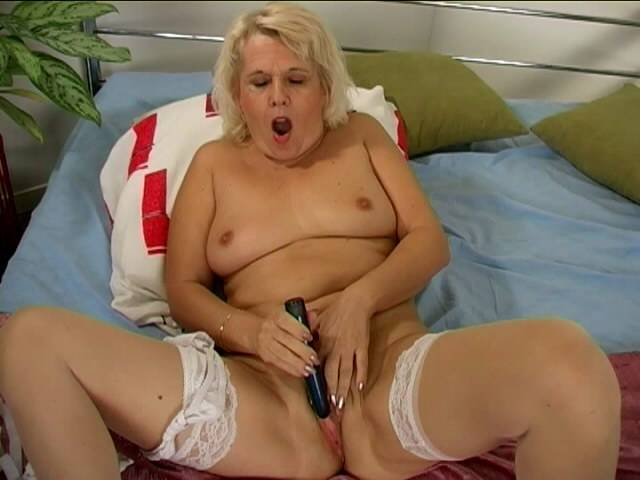 Amazing blonde granny in stockings Leona fingering her flooded cooter