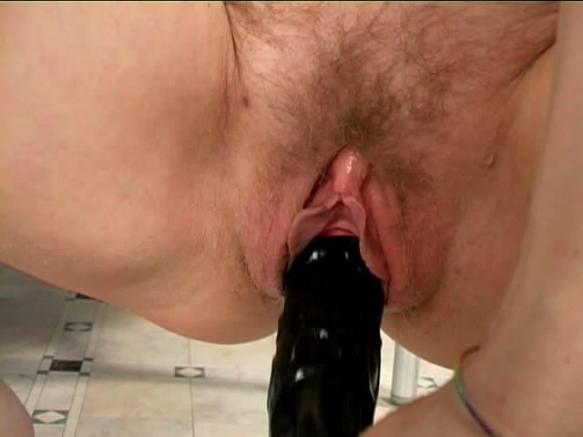 Nasty redhead granny Anna masturbating her hairy snatch with a huge black dildo