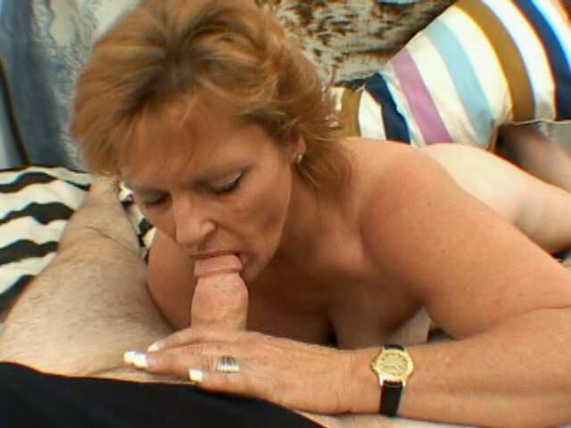 Smiling blonde granny directly giant tits Megan ribbons and slurps a close penis