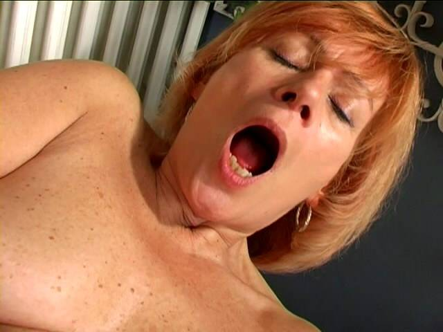 Charming granny Lady spreads pussy and fucks a giant white dildo