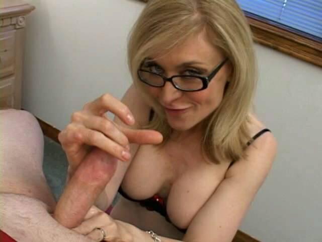 Sensational blonde granny in glasses Nina Hartley slurping a monster dong