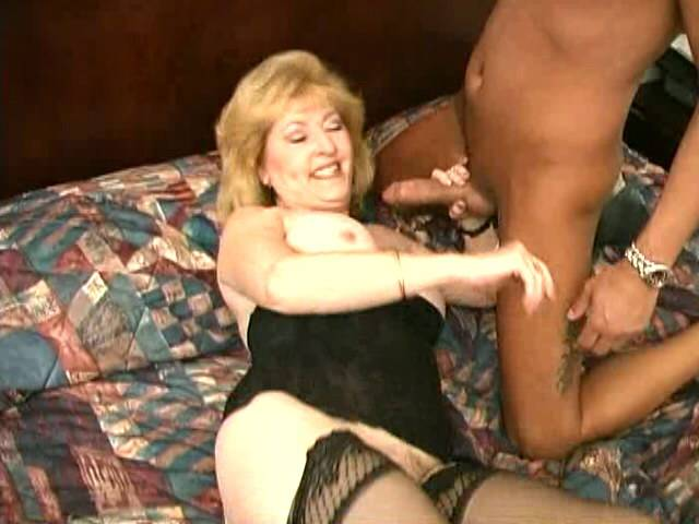 Stockinged granny Kitty Fox spreading and fingering her hairy pussy
