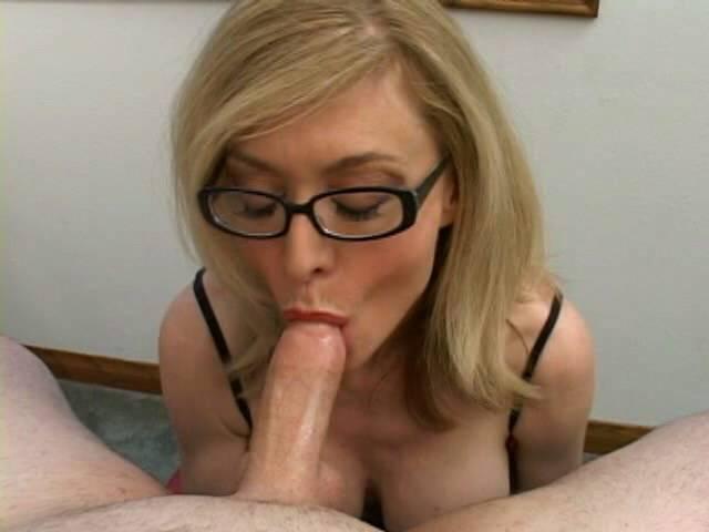 Stimulating blonde granny in glasses Nina Hartley sucking a gigantic shaft
