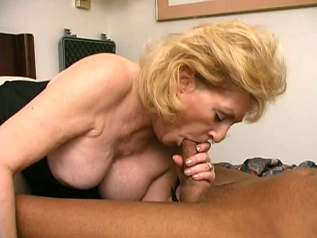 Sexual granny with giant tits Kitty Fox slurps a massive young penis
