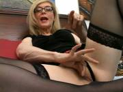 Stockinged blonde granny Nina Hartley hot airing and rubbing her shaved take or lay hold of; hold; US