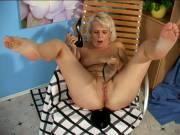 Beguilding blonde granny Leona masturbating her twat with her black nylons
